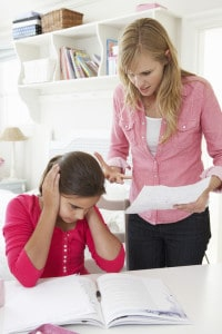 Mother disciplining child for behavior in school