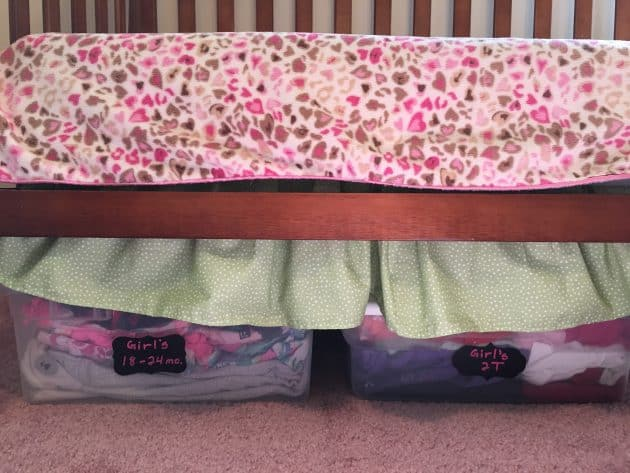 Store clothes that your kids have outgrown under the bed in small, labeled bins.