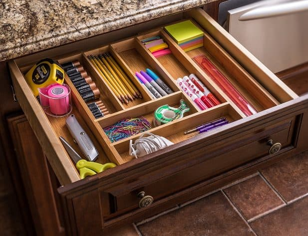 Toss everything that has no purpose or is expired, and then organize your junk drawer with an expandable utensil organizer.